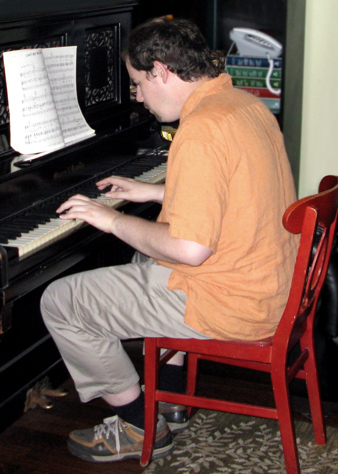 Academy House resident playing piano